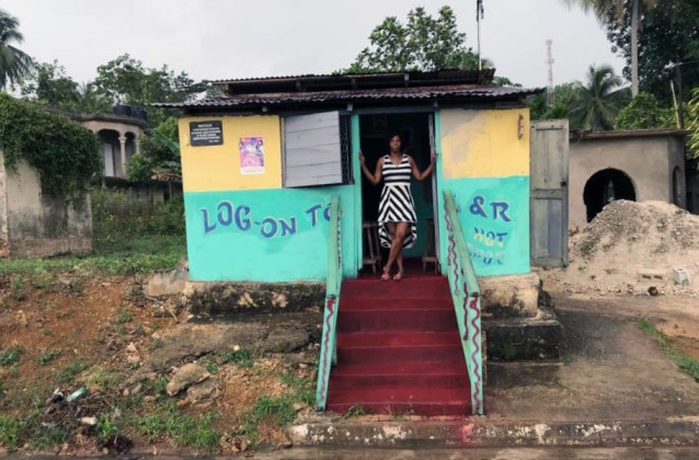 Jamaica in 24 Hours: An island adventure in a day - A house that has a sign on the side of a building - Trench Town