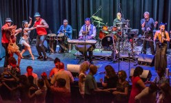 90 miles closer – Havana Nights Heats up the Stage at Key West Theater - A group of people sitting on a stage - Concert