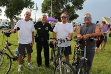 COMMUNITY PARTNERS – Family, food and fun with first responders - A group of people riding on the back of a bicycle - Cyclo-cross