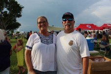 COMMUNITY PARTNERS – Family, food and fun with first responders - A couple of people that are standing in the grass - Weekly Newspapers
