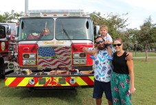 Fermin, Teddy and Megan check out the big red trucks during National Night Out at Key Largo Community Park.