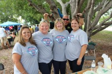 Photo bomb alert! Sgt. Scott Ward drops in with Haydee Martinez, Carol Albury-Johnson, Peggy Bryan and Clarisa Gonzalez.