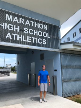 MHS Athletic Director Lance Martin stands at the entrance to the new athletic complex at the Middle Keys school.
