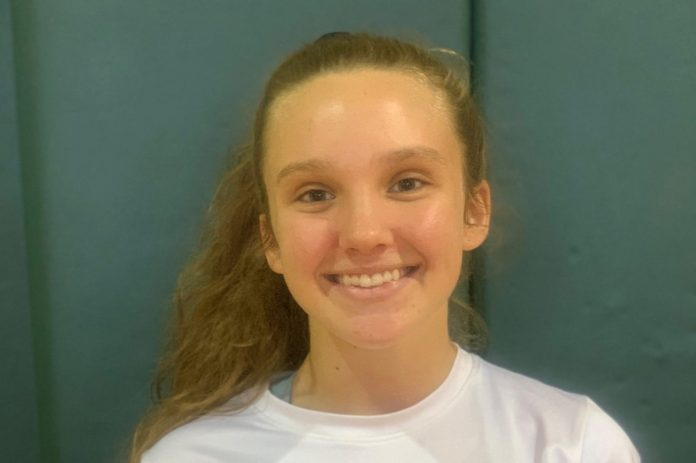 Coral Shores' Male and Female Athlete of the Week — Aug. 29 - A woman in a white shirt and smiling at the camera - Ear