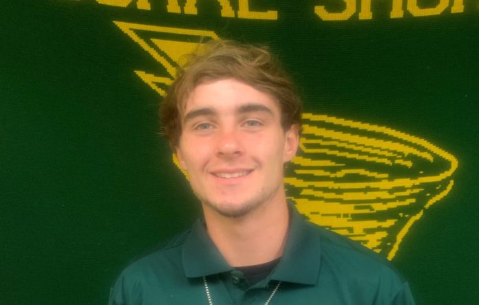 Coral Shores' Male and Female Athlete of the Week — Aug. 29 - A man smiling and wearing a green shirt - Beard