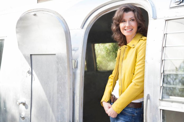 Amy Grant on Finding the Extraordinary Every Day - Amy Grant standing in front of a car - Amy Grant