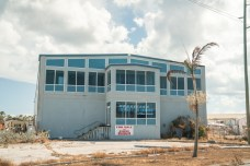 Keys Weekly photographer documents Bahamas plight - A bus parked in front of a building - Florida Keys