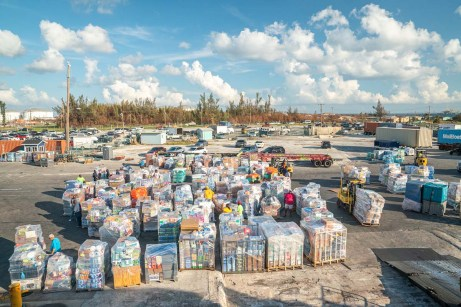 Keys Weekly photographer documents Bahamas plight - A car parked in a parking lot full of cars - Florida Keys