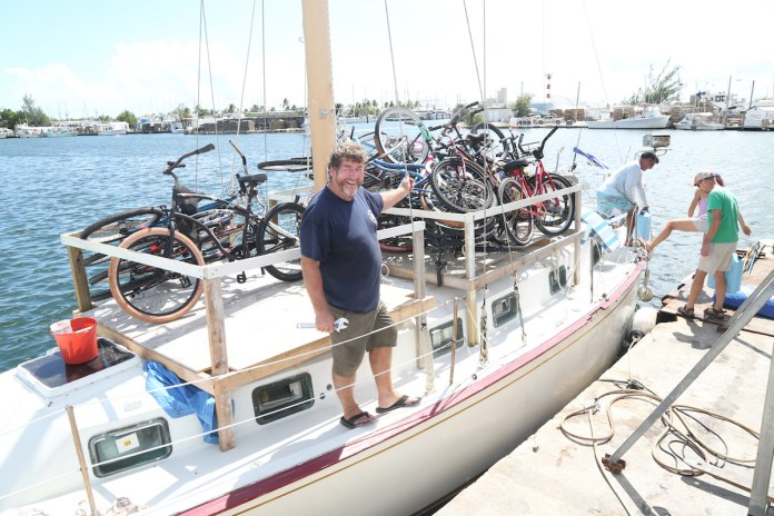 MORE HELP ON THE WAY – Conch Republic Navy sends relief to Bahamas - A group of people in a boat on a body of water - Sail