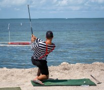 GOLFIN' CONCH STYLE – Funds raised for school, community programs - A man standing next to a body of water - Shore