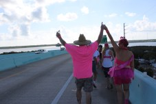 PINK ARMY – Inaugural bra walk in Key Largo sees large support - A person standing next to a body of water - Car