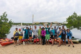 CELEBRATING CONSERVATION DECK: REEF Fest brings education, adventure - A group of people on a beach posing for the camera - Sea kayak