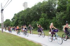 BROOMSTICK PARKING ONLY –AnnualWitches'Ride raises funds for cancer research - A group of people riding on the back of a bicycle - Road bicycle racing