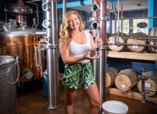 Stephanie Harper Head Brewer and  Distiller - A person standing in front of a building -