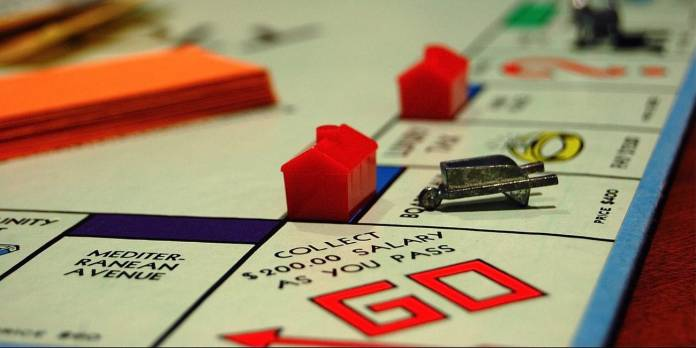 Celebrating 20 years: Marathon's roots traced back to property rights - A close up of text on a black background - Monopoly