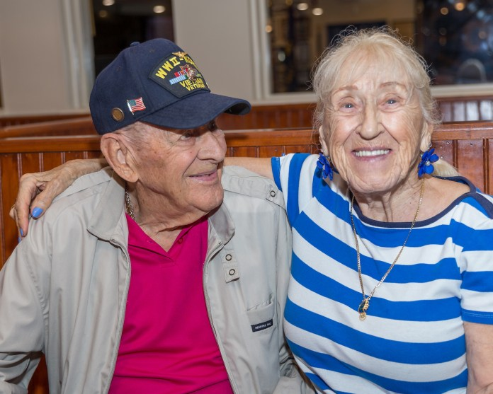 Keys Weekly honors local veterans - A man and a woman smiling for the camera - Socialite