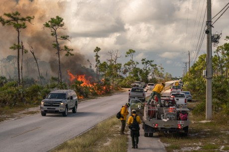 Big Pine gets burned – Controlled fire prevents catastrophe - A group of people riding on the back of a truck - Car