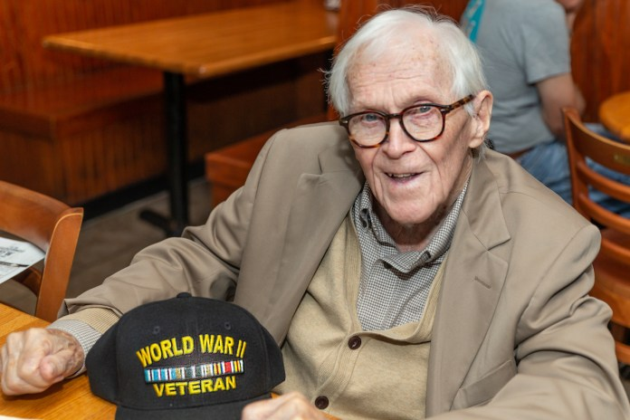 Keys Weekly honors local veterans - A man sitting on a table - Human behavior