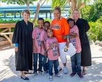 Wesley House celebrates Adoption Day - C.J. Sanders et al. posing for the camera - Car