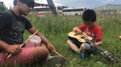 "Kevin Martinez, left, and his little ""host brother"" in Mongolia overcame language barriers with music. Contributed photo"