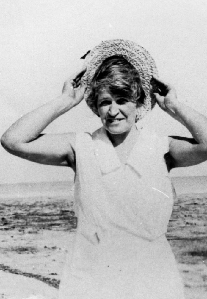 Keys History - Gertrude Robinson standing on a beach - Matecumbe
