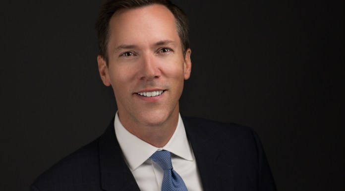 Barrett to challenge Ward in 2020 – Two seek state attorney post - A man wearing a suit and tie smiling at the camera - Florida