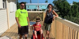 Guess what? Habitat is still helping homeowners recover from Irma - A group of people standing next to a fence - Roof