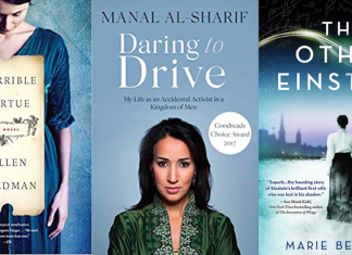 Women making a difference – The under-told stories of the 3 courageous women - Manal al-Sharif holding a sign - Daphne du Maurier