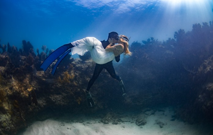 TOP 10 PHOTOS OF THE MIDDLE KEYS - A man flying through the air on top of a mountain - Free-diving
