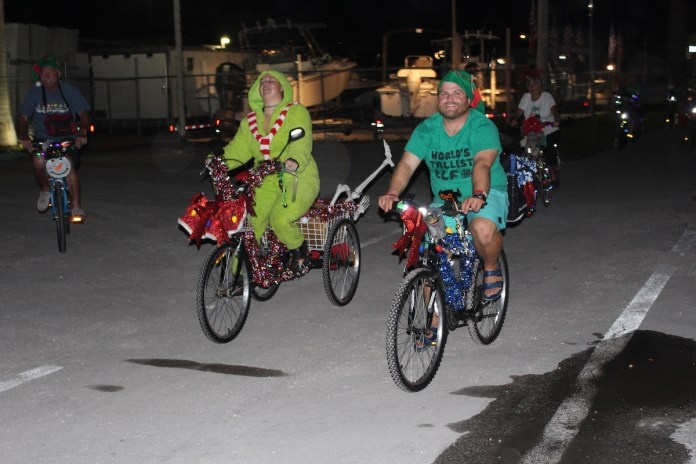 ROLLIN' INTO THE HOLIDAYS – Bike rides give back - A person riding a bicycle on a city street - Road bicycle