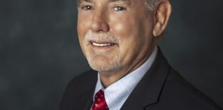 Forster named Mayor – Legalizing golf carts discussed - A man wearing a suit and tie - Business executive