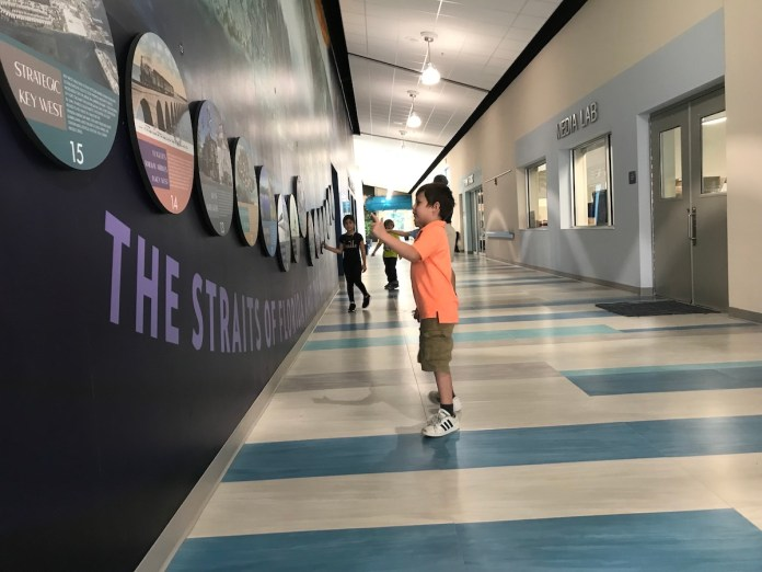 Keys schools get new fields and facilities - A man standing in a room - Jean Sport Aviation Center