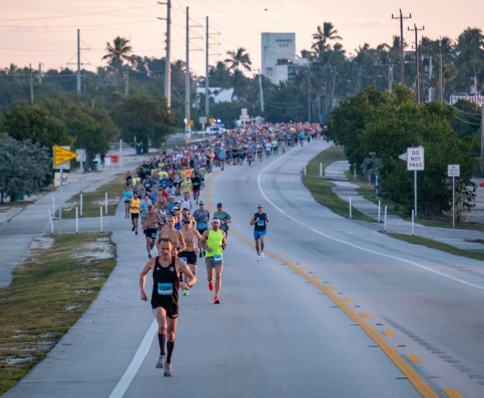 RUNNING THE ISLANDS - A group of people walking down the street - Marathon