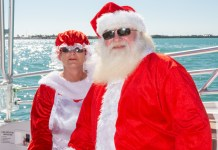 GLIDING INTO SEASON LIKE … - A person wearing a red hat - Santa Claus (M)