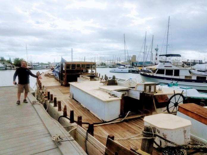 Saving a schooner – Historic flagship limps home to Key West - A boat docked at a dock - Boat