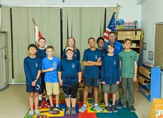 Thankful Troop Gives Back - Marie Critchley et al. posing for a picture - Indoor games and sports