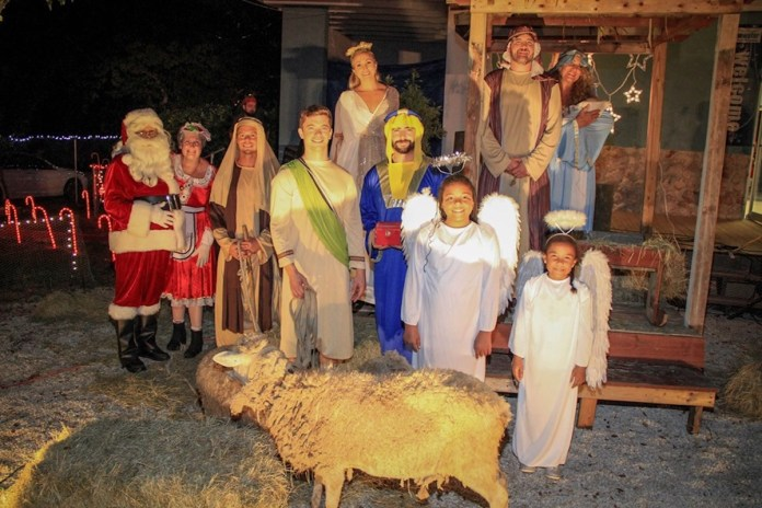 The keys get lit - A group of people posing for the camera - Nativity scene