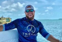 Upper Keys community remembers captain who lived big and loved hard - A man holding a fish in the water - Naples