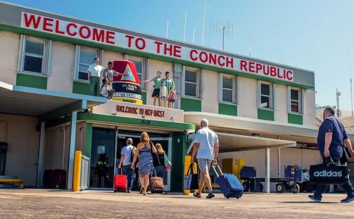 Airport master plan anticipates more plans, passengers - A group of people standing in front of a building - Key West International Airport