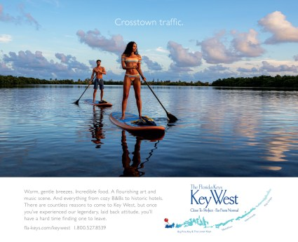 Striking 2020 ads lure various visitors to island chain - A man rowing a boat in a body of water - Florida Keys