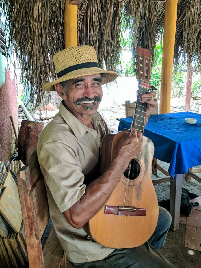 Learn about how to travel to Cuba at Marathon Library talk - A person wearing a hat - Tiple