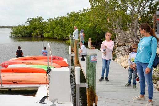 Kids enjoy Fish for Fun Day at Crane Point.