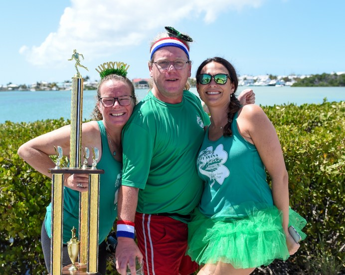 Havana Jack's relay team — Megan Mertsock, left, Bryan Davis and Kim Young — took first place in the relay division and brought their own trophy.
