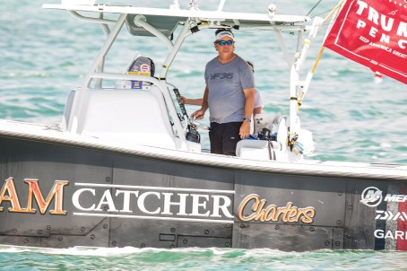 Capt. Steve Lamp of Dream Catcher Charters motors through Key West Harbor during the Boat for Trump flotilla. LARRY BLACKBURN/Keys Weekly
