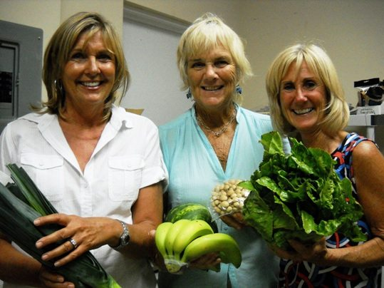 Kathy Delashmutt, Brenda Duff and the newest owner of Food for Thought in Marathon, Ellin Meade, enjoy the weekly delivery of fresh organic produce like leeks, bananas, watermelon, Brown Beech mushrooms and lettuce from Annie's Buying Club.