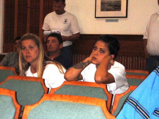 Two Key West Rescue employees watch City Clerk Cheri Smith apply the commissioner's rankings with uncertainty
