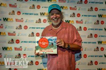 Howard Livingston holding a sign - Florida Keys