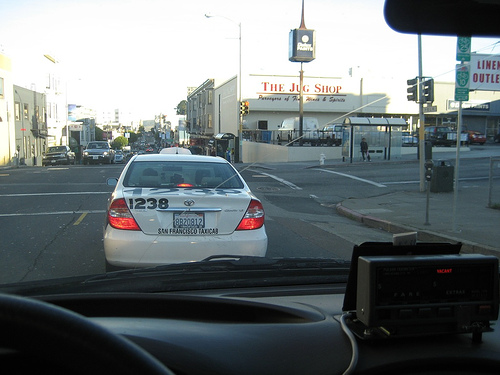 A Luxor Cab stopped at an intersection