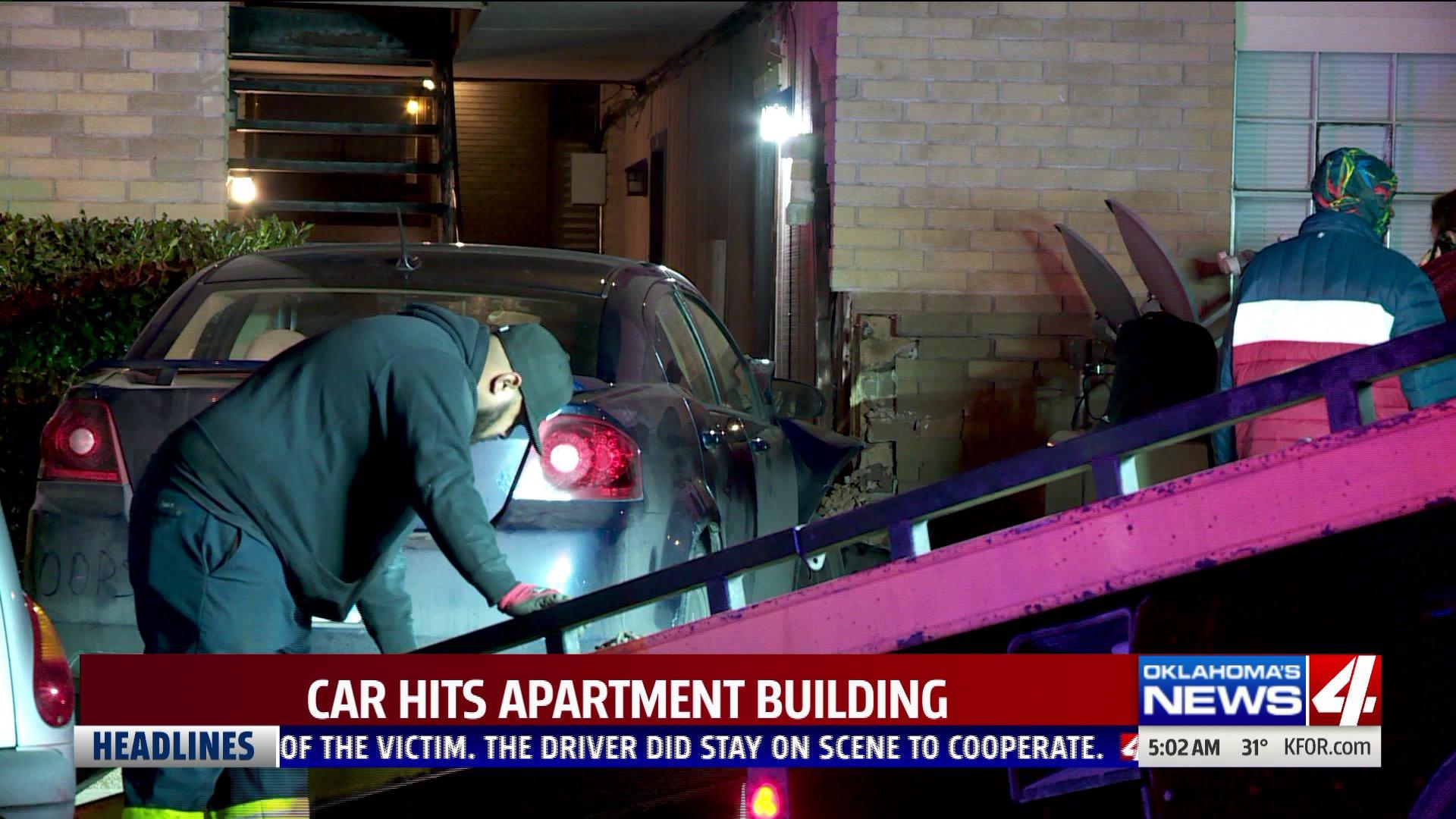 Car crashes into apartment building