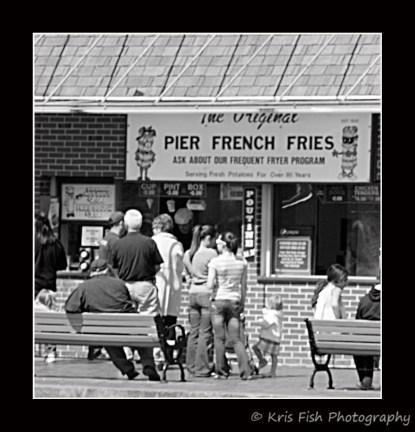 People of all ages waiting in line for some fresh, hand cut, original Pier Fries